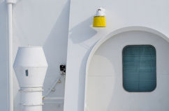 Abstract composition of passenger ship side painted with white color whi Stock Photo