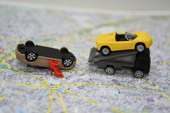 Abstract composition on the road accident. Paper map with small toy cars Royalty Free Stock Photography