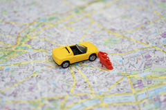 Abstract composition with small car and city map. stock images