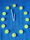 Abstract composition symbolising New Year clock. On a blue background. Concept of New Year coming Royalty Free Stock Photo