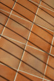 Abstract composition with terracotta tiles and fence shadows Royalty Free Stock Photo