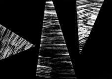 An abstract composition of three triangles creates the image of bird beaks. Energy