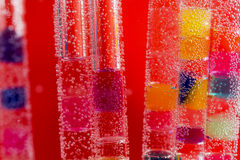 Abstract composition with underwater tubes with colorful jelly balls and bubbles Royalty Free Stock Photography