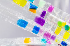 Abstract composition with underwater tubes with colorful jelly balls inside Royalty Free Stock Image