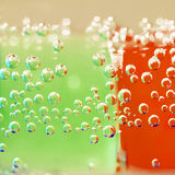 Abstract composition with underwater tubes with colorful jelly balls inside Stock Photo