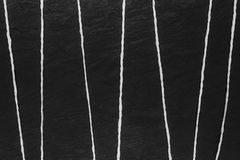 Abstract composition of white thread on black stone background surface stock photography