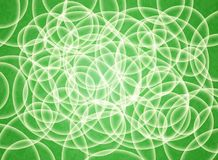 Abstract composition of white volume circles on a green substrate. 3d background. Abstract composition of white volume circles on a green and orange substrate Stock Photography