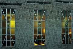 Stained Glass Windows, with Afternoon Sun Shining in from the West. Abstract Composition of Windows, and bricks, Frames inside Frames. Stained Glass Windows stock image