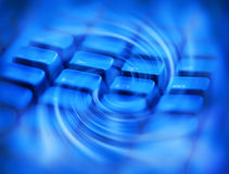 Abstract Computer Technology Background. An abstract computer keyboard background with a swirl pattern and blue tones Royalty Free Stock Photo