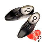 Abstract the concept of black shoes located in woman`s heart. Is. Abstract the concept of black shoes located in woman`s heart.  on white. Hard choice, lover Royalty Free Stock Photos