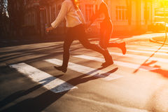 Abstract concept of couple crossing street Royalty Free Stock Photos