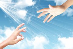 Abstract concept hand towards sky, ray of light Royalty Free Stock Image