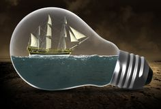 Tall Sailing Ship, Surreal Light Bulb, Water stock photo
