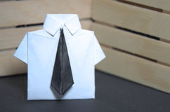 Abstract concept of white collar worker with origami suit and black tie Stock Photos