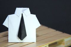 Abstract concept of white collar worker with origami suit and black tie Stock Images