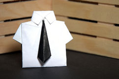 Abstract concept of white collar worker with origami suit and black tie Royalty Free Stock Photo