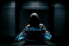 Abstract conception of hacker. That takes control over laptop stock photo