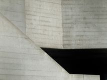 Abstract concrete beton cast grey walls with angles and inclines. With cast texture Stock Photos