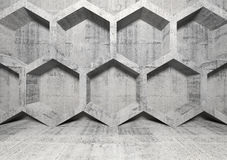 Abstract concrete interior with honeycomb on the wall Royalty Free Stock Photo
