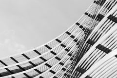 Abstract construction details of a modern skyscraper. Facade made of glass and steel black and white version Stock Photos