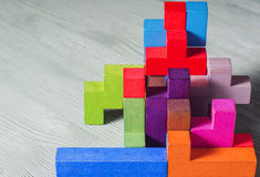 Abstract construction from wooden blocks tetris shapes. Royalty Free Stock Photo