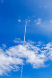 Abstract contrail cloud on the blue sky Stock Photo