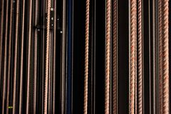 Abstract cord pattern with a black background. Abstract cord texture pattern with a black background. Different thick ropes royalty free stock photo