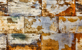 Abstract corroded colorful rusty background, old wall texture Stock Images