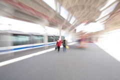 Abstract couple People on train station zoom blur. Abstract couple People on a train station zoom blur Royalty Free Stock Photos