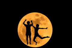 Abstract couples leap at super moon Royalty Free Stock Photos