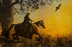 An abstract cowboy riding in the mountains with trees, crows flying above and a textured watercolor yellow background. A cowboy riding his horse in the Royalty Free Stock Photo