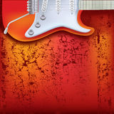 Abstract cracked background electric guitar. Abstract cracked background red electric guitar Royalty Free Stock Photo
