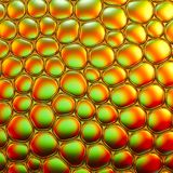 Abstract image of soap bubbles. Abstract creative image of soap bubbles with colorful background. Vivid golden yellow and orange colors make this image very eye Royalty Free Stock Photo