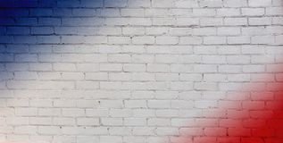 Abstract creative patriotic Background. Art pattern of White, red and blue colors on Brick Wall Texture. Concept flags of USA and France. Wallpaper or Web stock images