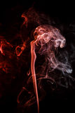 Abstract crimson smoke from aromatic sticks. Royalty Free Stock Image