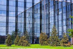 Abstract crop of modern office. Blue abstract crop of modern office skyscraper an� green trees Stock Photo