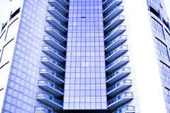 Abstract crop of modern office skyscraper. In blue colours Royalty Free Stock Image