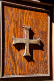 Abstract cross     knocker in a   closed wood door  castiglione Royalty Free Stock Image