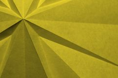 Abstract cross shape from folded paper. stock images