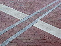 Abstract cross sign on red brick square, Stock Photos
