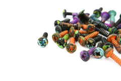 Abstract of crosshead screws, covered in paint splatters Royalty Free Stock Images