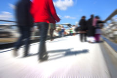 Abstract crowd of people. Abstract people walking motion blur over millenium bridge in london Royalty Free Stock Image