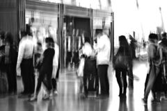Traveler silhouettes in motion blur, airport interior royalty free stock images