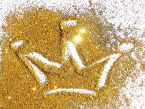 Abstract crown of golden glitter on white background Stock Photography
