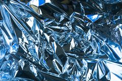 Abstract crumpled foil background. Grunge photo background. Light blue color.  stock image