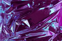 Abstract crumpled foil background. Grunge photo background. Neon colors. Blue and purple colors.  royalty free stock photography