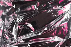 Abstract crumpled foil background. Grunge photo background. Pink shadows.  royalty free stock images