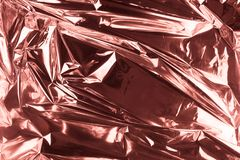 Abstract crumpled foil background. Grunge photo background. Rose gold.  stock image