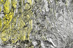 Abstract crumpled foil background. Grunge photo background. Yellow shadows.  stock photography