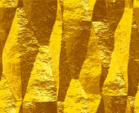 Abstract crumpled gold pattern of folded brushed foil Royalty Free Stock Photo